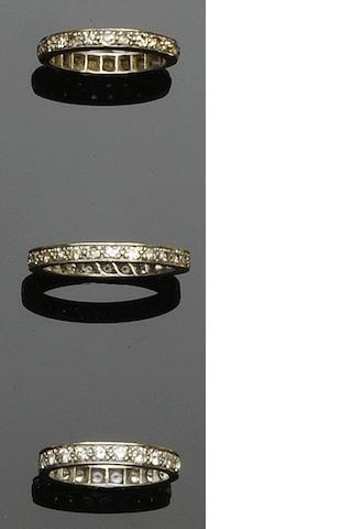 Three diamond full hoop eternity rings (3)