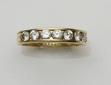 A diamond half hoop eternity ring