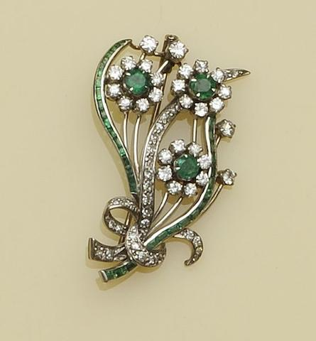 An emerald and diamond floral spray brooch