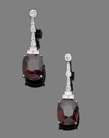 A pair of garnet and diamond pendent earrings