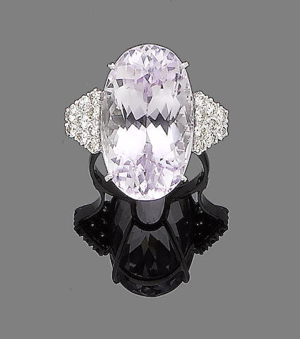 A kunzite and diamond cluster ring