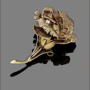 A gold and diamond flower brooch,  by Cartier,