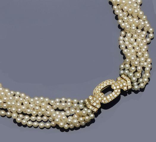 A cultured pearl and diamond torsade necklace