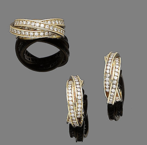 A diamond-set 'Trinity' ring and earclip suite, by Cartier (2)