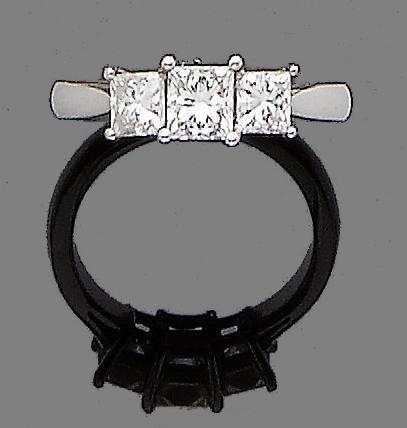 A diamond three-stone diamond ring