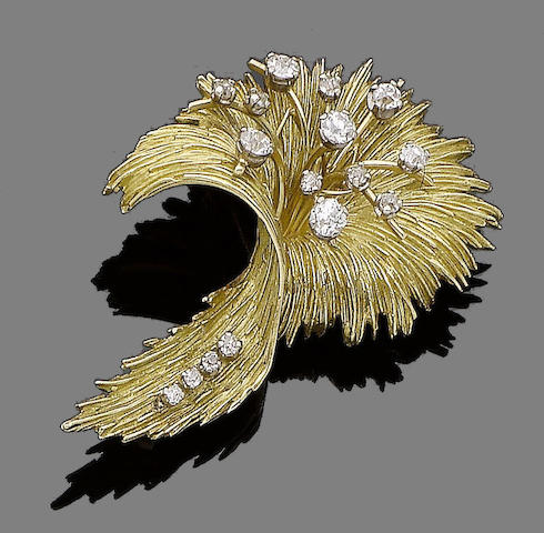 A gold and diamond brooch,