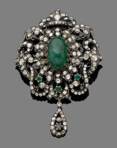 An emerald and diamond brooch/pendant,