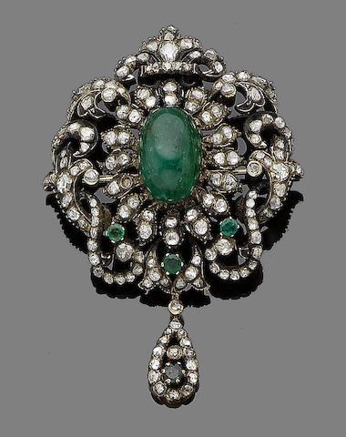 An emerald and diamond brooch/pendant,