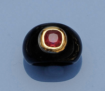 A ruby and black stone dress ring
