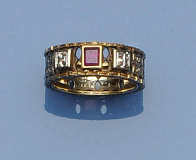 A diamond and ruby three stone band ring