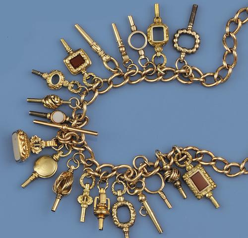 A 9ct gold curb-link watch part Albert chain