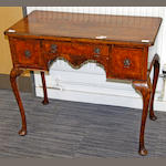A walnut dressing table in the Queen Anne taste,