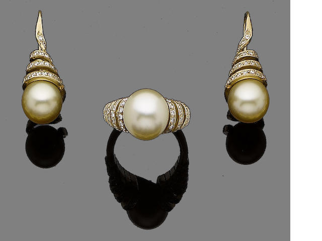 A cultured pearl and diamond ring, pendant and earring suite (3)