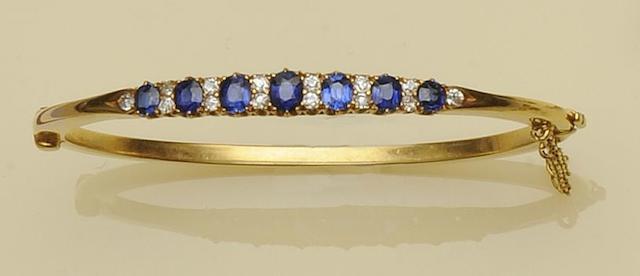 A sapphire and diamond hinged bangle