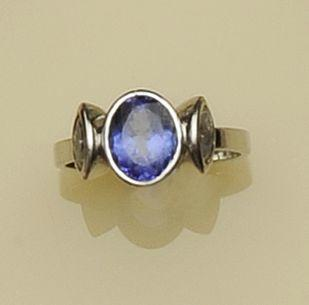 A tanzanite and diamond three stone ring