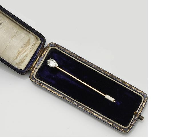 A diamond single stone stick pin