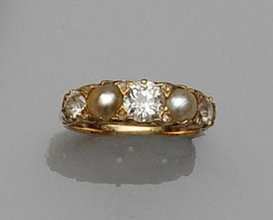 A diamond and half pearl ring