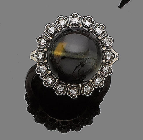 A hawk's-eye and diamond ring