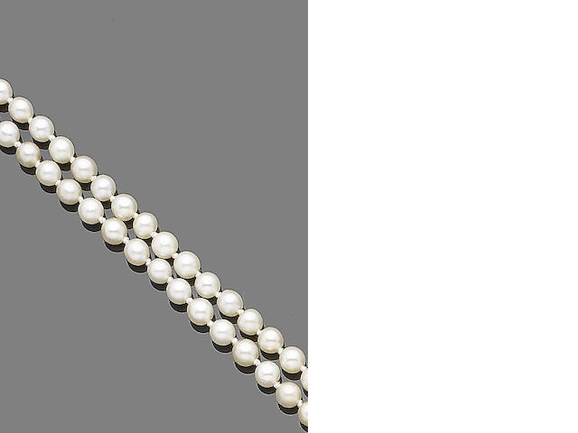 A single-strand pearl necklace with diamond clasp