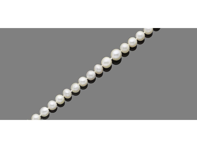 A single-strand natural pearl necklace with diamond-set clasp