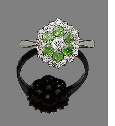 A demantoid garnet and diamond ring