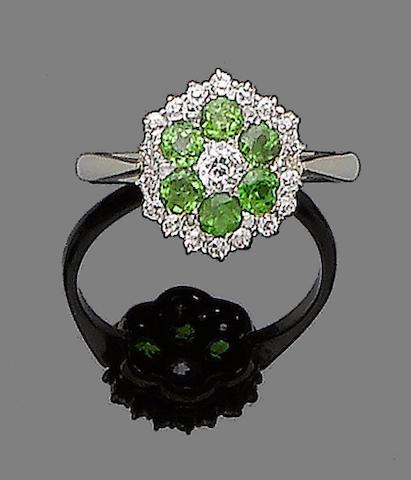 A demantoid garnet and diamond ring
