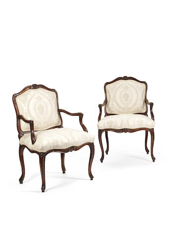 A pair of French 18th century Louis XV walnut fauteuils à la reineby François Hortaux (active circa 1730-1760)