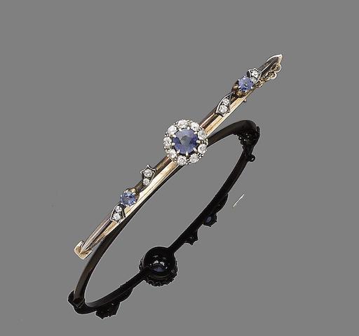 A sapphire and diamond bangle, (2)