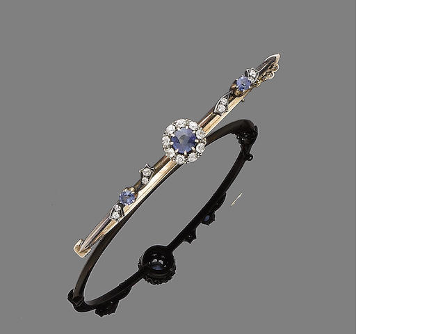 A sapphire and diamond bangle, (2)