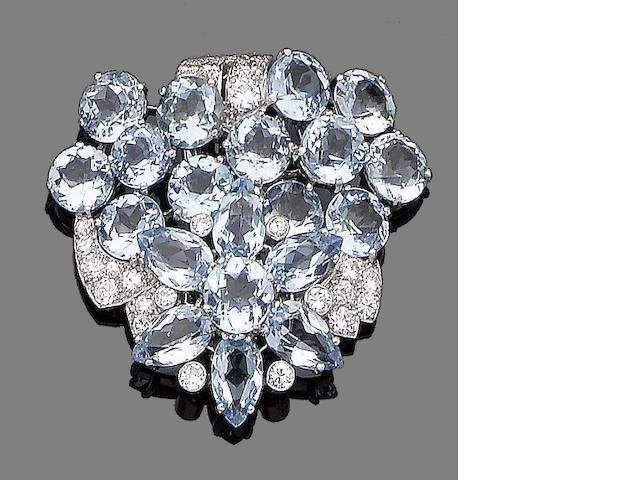 An aquamarine and diamond clip brooch, by Cartier,