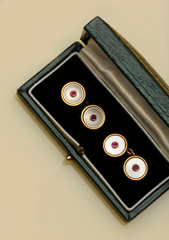 A pair of ruby and mother o' pearl cufflinks