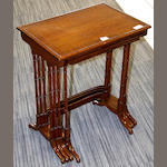 A nest of Edwardian mahogany and crossbanded quartetto tables