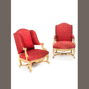 A matched pair of early 20th century Louis XV style giltwood fauteuils