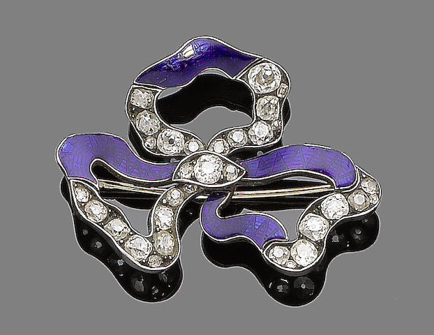 An enamel and diamond brooch,