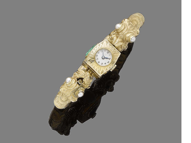 A gem-set bangle/wristwatch