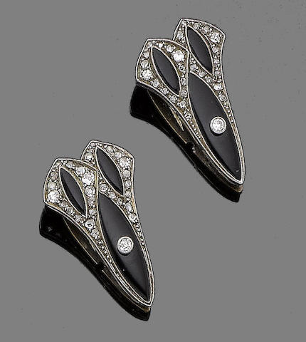 A pair of onyx and diamond clip brooches,
