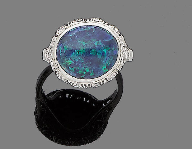 An opal and diamond ring