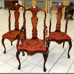 Three Dutch walnut and mahogany marquetery inlaid chairs,