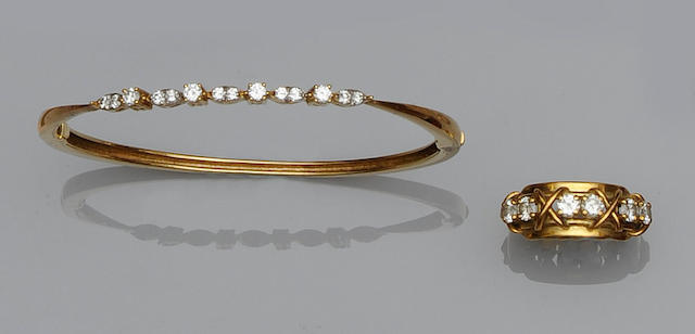 A diamond half hoop ring and a diamond bangle (2)