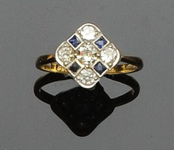 A sapphire and diamond panel ring