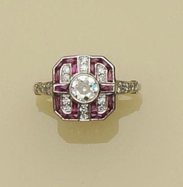 An Art Deco style ruby and diamond panel ring