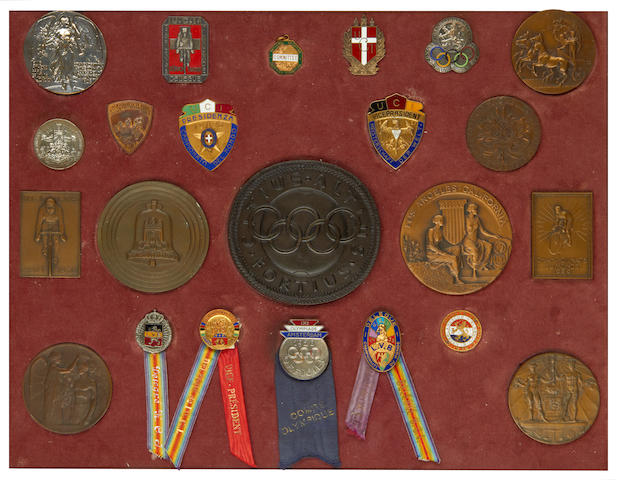 A framed and glazed collection of Cycling medals and badges including Olympic Games 1908-1932