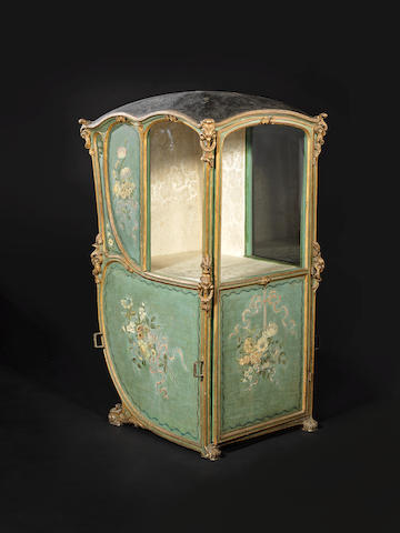 A Venetian late 18th century leather, gilt and green-ground painted carved wood sedan chair