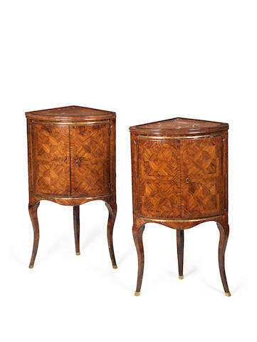 A pair of Genoese 18th century brass mounted kingwood parquetry corner commodini