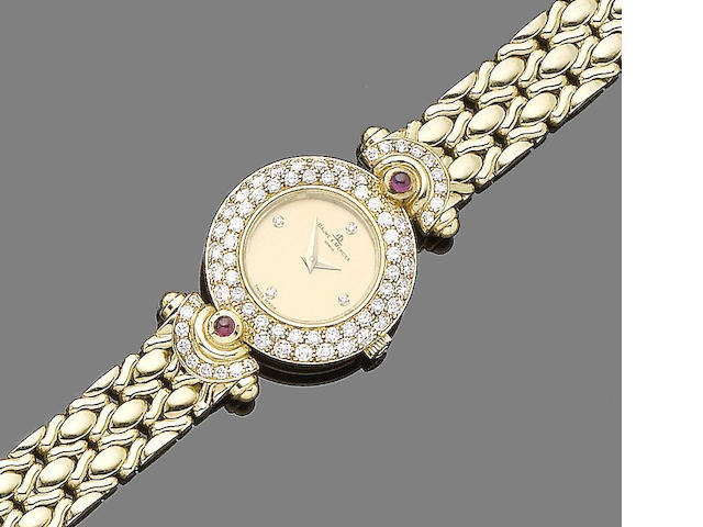 A ruby and diamond-set wristwatch, by Baume & Mercier