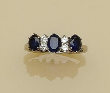 A platinum diamond and sapphire ring