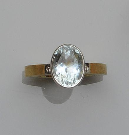 An aquamarine and diamond ring