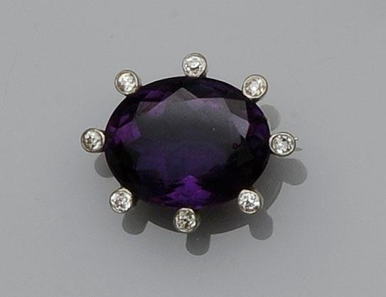 An amethyst and diamond brooch,