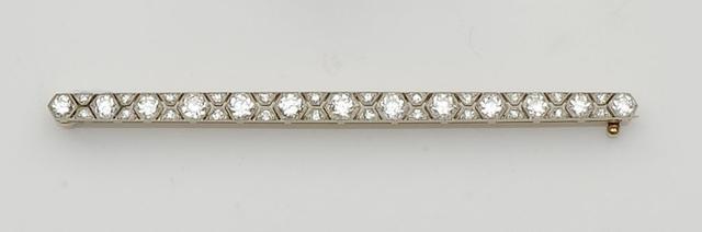 A diamond bar brooch,