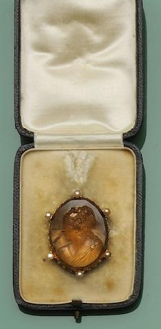 A citrine and half pearl cameo brooch
